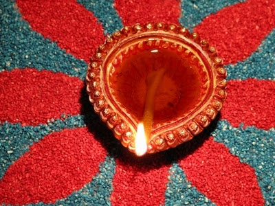 Diya or Deepak, an oil lamp usually made from clay, with a cotton wick dipped in ghee or vegetable oil.